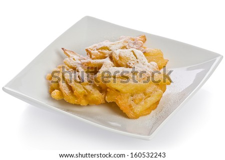 Homemade apple fritters on a white appetizer plate. - stock photo