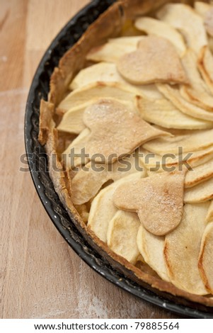 Homemade apple pie decorated with hearts. - stock photo