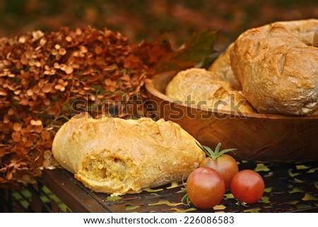 Homemade artisan sourdough bread in autumn setting - stock photo