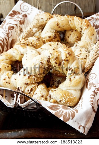 Homemade Bagels with Sesame and Flax Seeds,Salty Bagels Snack in a Basket with Seeds - stock photo