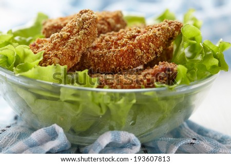 Homemade baked chicken nuggets in cheesy crumb - stock photo