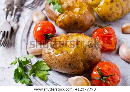 Homemade baked potato with bacon and vegetables. Selective focus. - stock photo