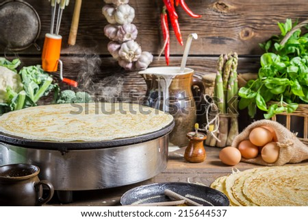 Homemade baking pancakes in the countryside - stock photo