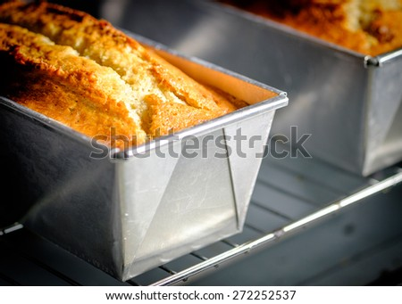 Homemade Banana Bread or Cake in a stainless tray fresh from the oven. - stock photo