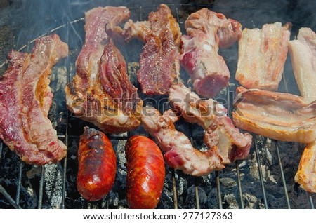 Homemade barbecue. Meat and chorizo cooked over charcoal - stock photo