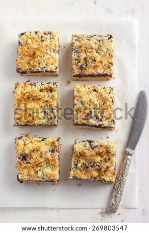 Homemade berries  crumble bars  on white background, top view - stock photo