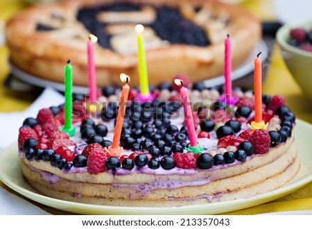 homemade birthday berry pie with seven candles closeup - stock photo