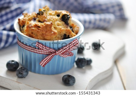 Homemade blueberry muffin with fresh blueberry  closeup - stock photo