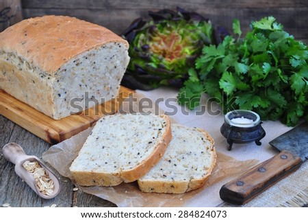 Homemade bread with oat flakes, linseed and black sesame seeds - stock photo