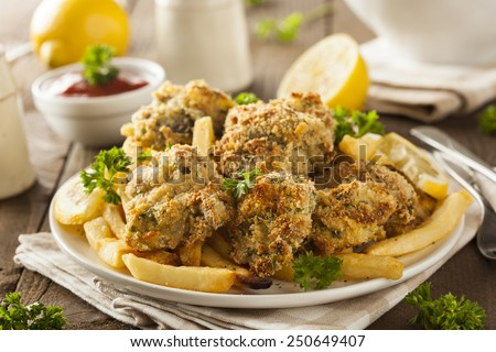 Homemade Breaded Fried Oysters with French Fries - stock photo