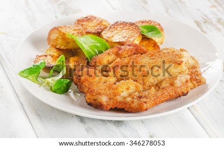 Homemade Breaded Wiener Pork Schnitzel with Potatoes. Selective focus - stock photo