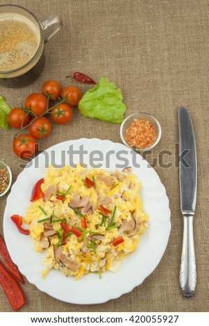 Homemade breakfast with a cup of coffee.Fresh scrambled eggs with bacon and vegetables. Breakfast athletes. Preparing eggs. Protein diet. Eggs in different kinds of preparations. - stock photo