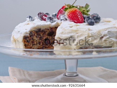 Homemade cake with fresh berries, one slice out - stock photo
