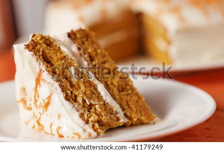 Homemade carrot cake dessert on white plate.Very shallow depth of field. - stock photo