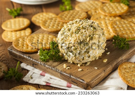 Homemade Cheeseball with Nuts and Wheat Crackers - stock photo