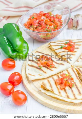 Homemade chicken-cheese quesadilla with salsa on top - stock photo