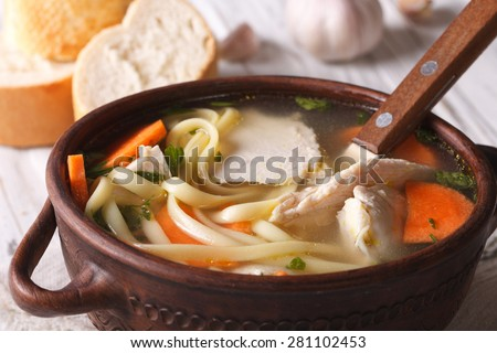Homemade chicken soup with noodles and vegetables close-up. horizontal - stock photo