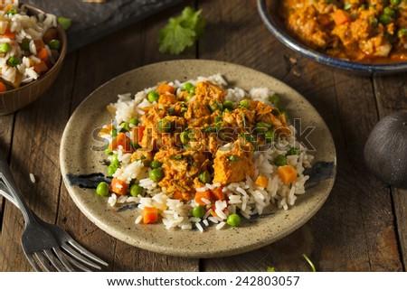 Homemade Chicken Tikka Masala with Rice and Naan - stock photo