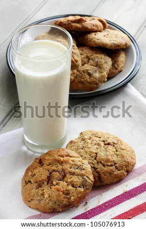 Homemade chocolate and nut cookies with a glass of milk - stock photo