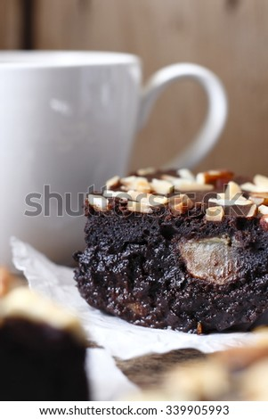 homemade chocolate brownies mix with banana inside its meat and a cup of coffee. - stock photo