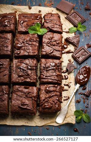 homemade chocolate brownies on dark background, top view - stock photo