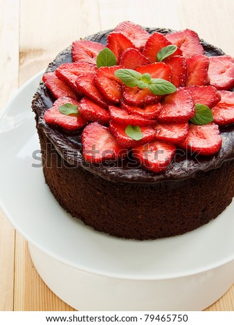 Homemade chocolate cake with strawberry and mint. Shallow dof. - stock photo