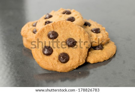 homemade chocolate chip cookies on baking sheet - stock photo