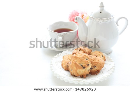 Homemade chocolate chips cookie and English tea - stock photo