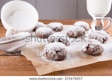 Homemade chocolate crinkles cookies with powdered sugar. - stock photo