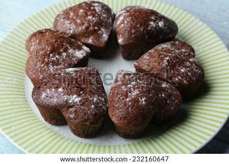 Homemade chocolate cupcakes on table - stock photo