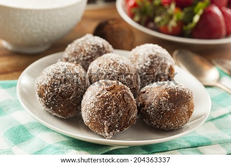 Homemade Chocolate Donut Holes with Sugar for Breakfast - stock photo
