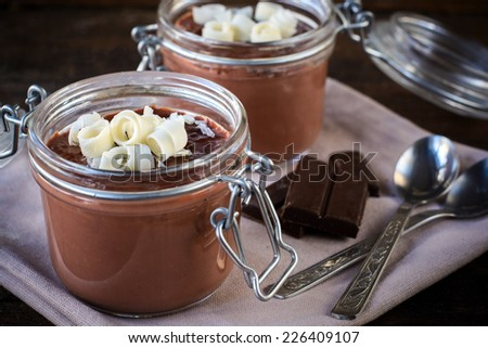 Homemade chocolate pudding in the jars,selective focus - stock photo