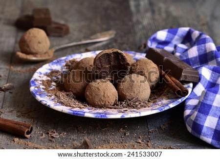 Homemade chocolate truffles on a plate. - stock photo