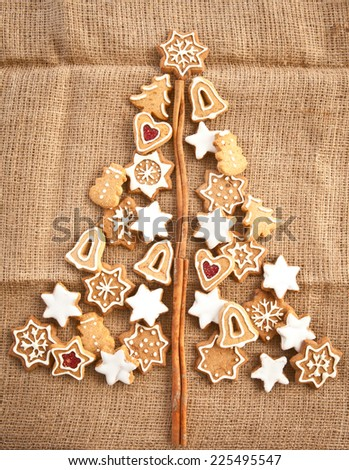 Homemade christmas cookies on a background made of burlap - stock photo