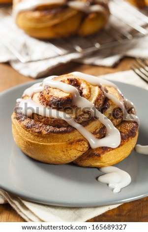 Homemade Cinnamon Roll Pastry with Vanilla Icing - stock photo