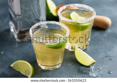 Homemade classic margarita drink with lime and salt, selective focus - stock photo