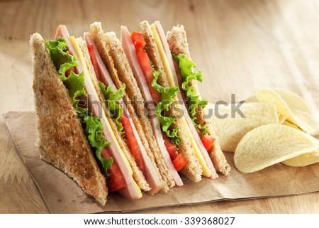 homemade club sandwich with potato chip - stock photo