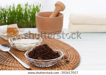 Homemade coffee scrub with honey, yogurt, coffee grounds and essential oil - stock photo