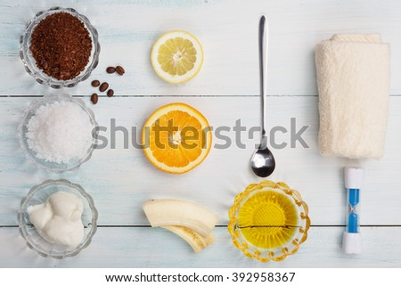 Homemade coffee scrub with lemon, orange, banana, sea salt, honey, top view, flat lay - stock photo