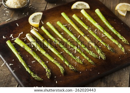 Homemade Cooked Green Asparagus with Lemon and Cheese - stock photo