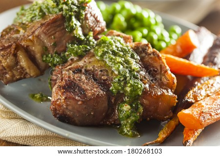 Homemade Cooked Lamb Chops with Peas and Carrots - stock photo
