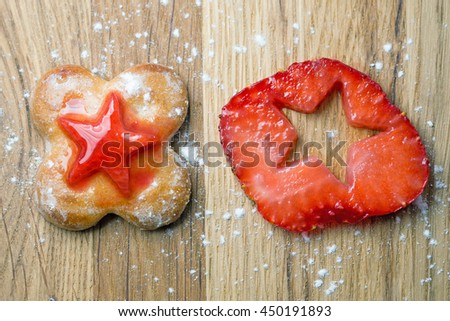 Homemade cookie on the wooden backgraund and creative fruit Strawberry in the shape of a star. - stock photo
