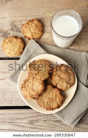 Homemade cookies and glass of milk on table close up - stock photo