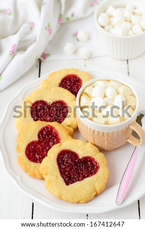 Homemade Cookies with Heart-Shaped Center and a Cup of Hot Chocolate with Marshmallow, copy space for your text - stock photo