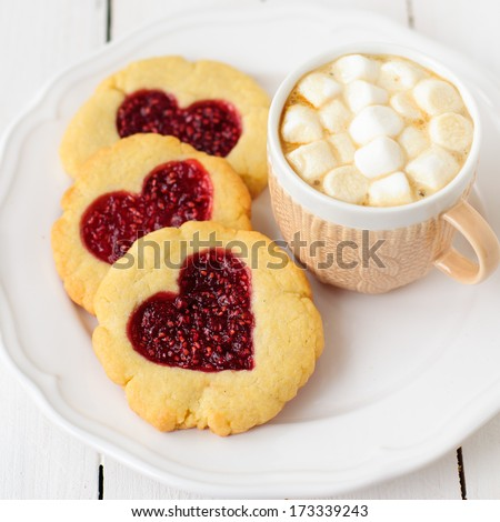 Homemade Cookies with Heart-Shaped Center and a Cup of Hot Chocolate with Marshmallow, square, copy space for your text - stock photo