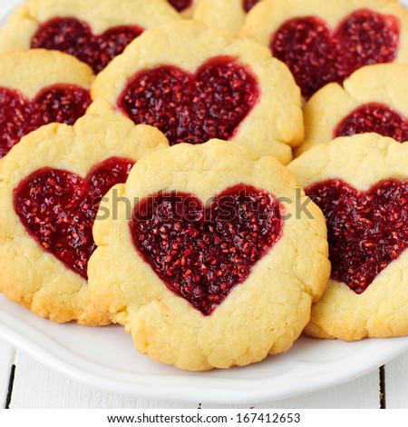 Homemade Cookies with Heart-Shaped Center on a White Plate, square - stock photo