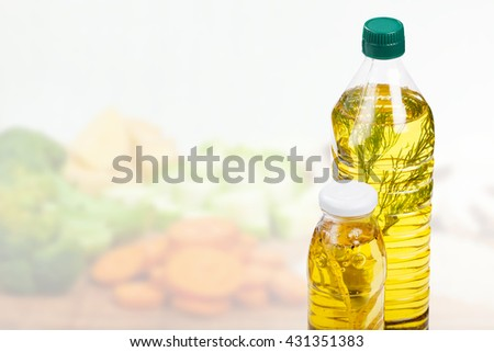 Homemade cooking concept. Exotic homemade oil on foreground and vegetables on background - stock photo
