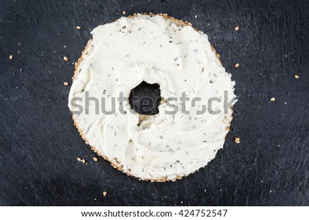 Homemade cream cheese Bagel (selective focus; close-up shot) - stock photo