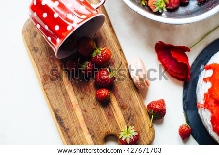 Homemade cream layer cake, fresh, colorful, and delicious dessert with juicy strawberries, sweet whipped cream, cream cheese and macaroons - stock photo