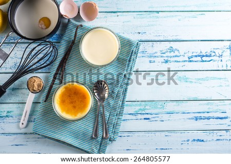 homemade creme brulee recipe border background from above - stock photo